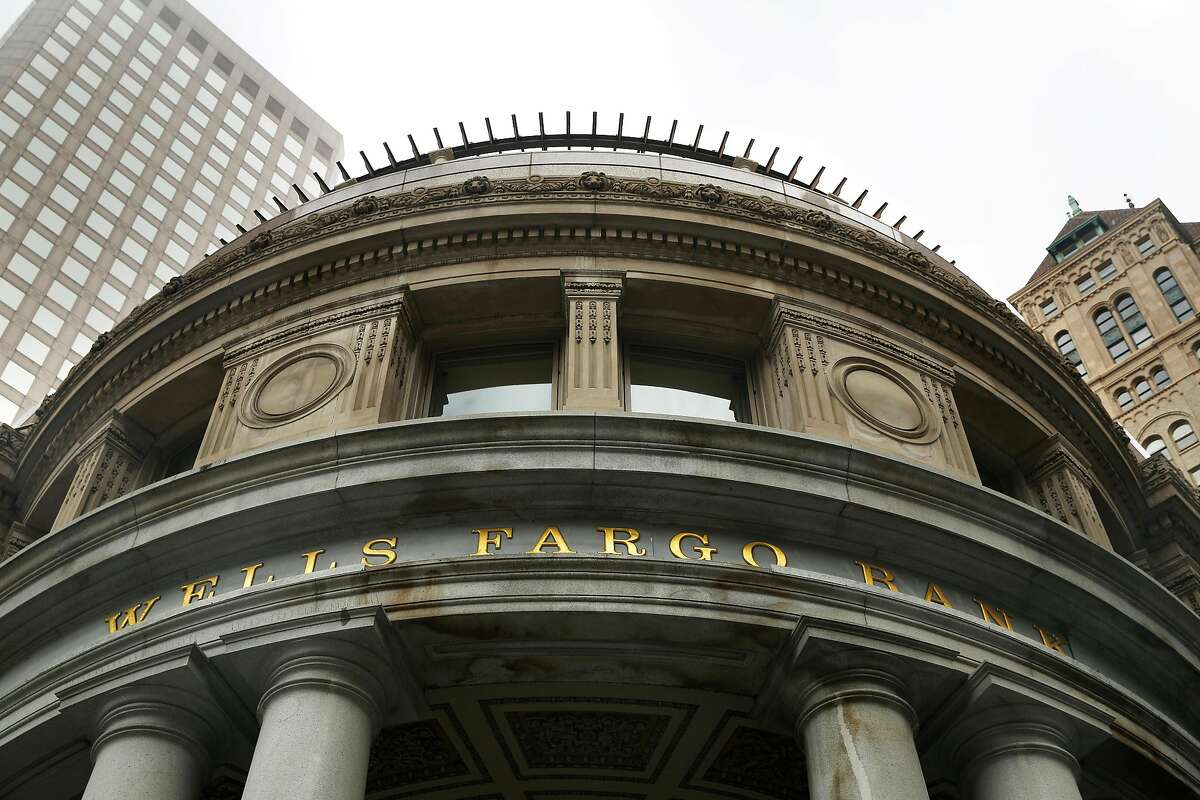 Signage on the Wells Fargo bank at 1 Montgomery Street is seen on Tuesday, July 30, 2019 in San Francisco, Calif.
