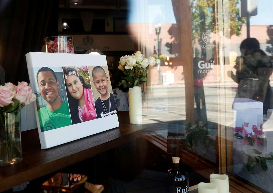 """Gilroy Garlic Festival shooting victims, Trevor Irby, Keyla Salazar, 13,  and  Stephen Romero, 6, are memorialized in the window of The Realty Society on Monterey Street in historic downtown Gilroy, Calif., on Thursday, August 1, 2019. While mass shootings still occur with too much regularity in California, a new UC Davis study suggests the state's """"red flag"""" law may be effective in preventing some mass shootings. Photo: Scott Strazzante / The Chronicle"""