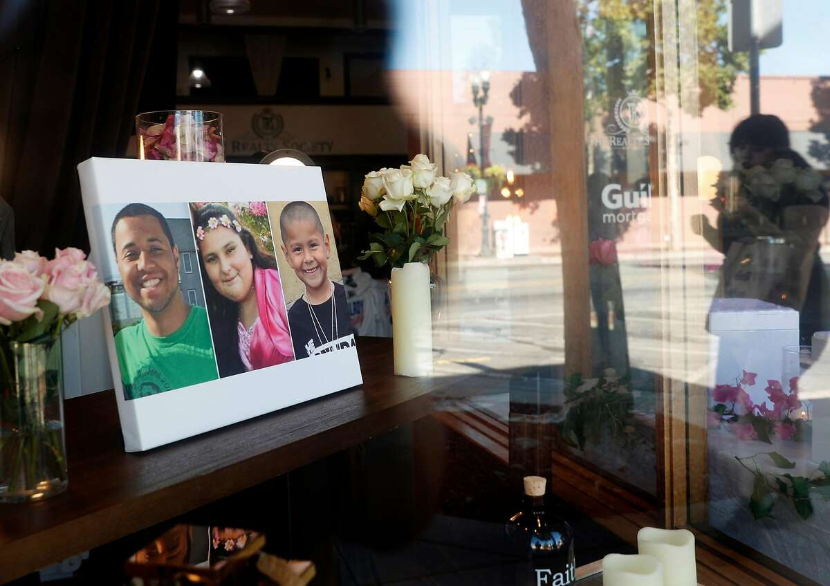 Gilroy Garlic Festival shooting victims, Trevor Irby, Keyla Salazar, 13, and Stephen Romero, 6, are memorialized in the window of The Realty Society on Monterey Street in historic downtown Gilroy, Calif., on Thursday, August 1, 2019. While mass shootings still occur with too much regularity in California, a new UC Davis study suggests the state's