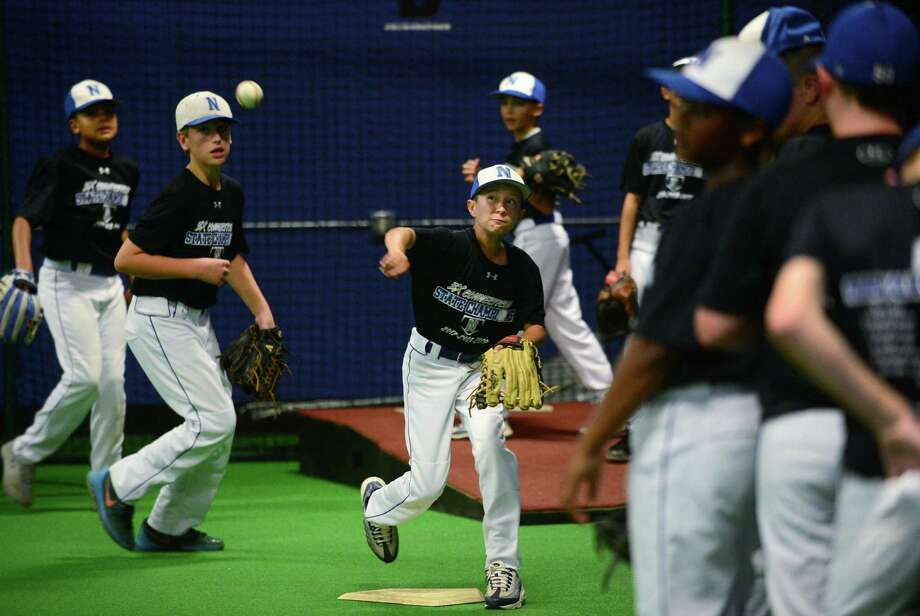 Players with Norwalk's 11U Cal Ripken All-Star baseball team, including Matthew Rinaldi, center, practice at The Factory, Wednesday, July 31, 2019, in Norwalk, Conn. The team beat Greenwich in regionals last weekend to qualify for next year's Cal Ripken World Series. Photo: Erik Trautmann / Hearst Connecticut Media / Norwalk Hour