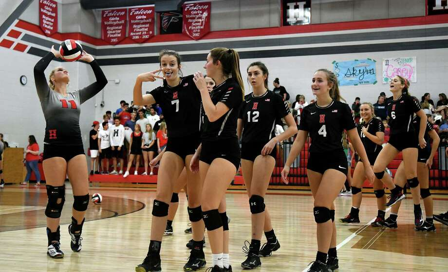 Huffman-Hargrave volleyballers Kylie Willis (7), Saylor Boss (2), and Tina Alley (4) team up in celebration after the Falcons striaght-set win over Livingston at Huffman-Hargrave High School on Sept. 28, 2018. Photo: Jerry Baker, Houston Chronicle / Contributor / Houston Chronicle
