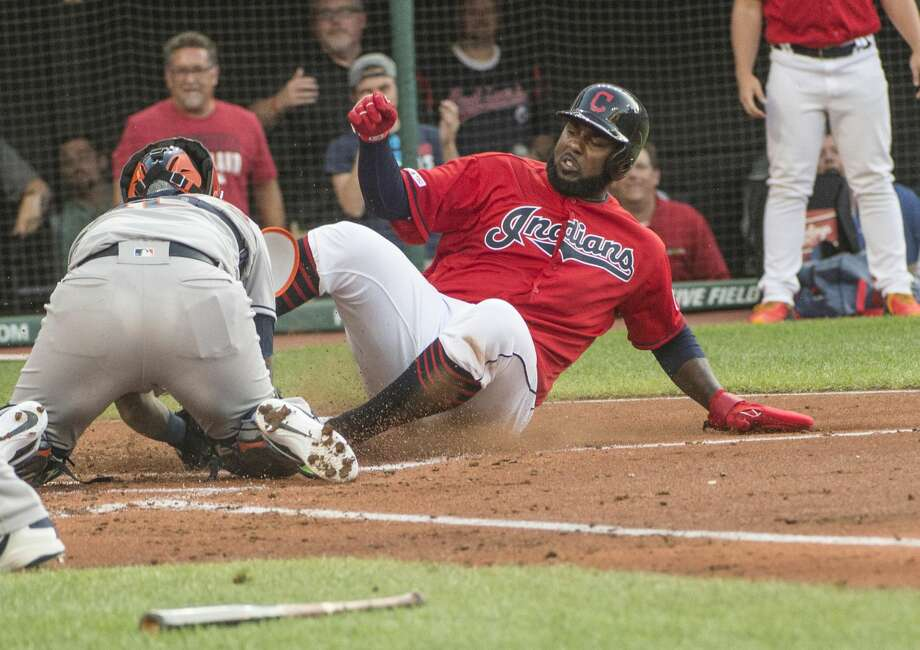 Houston Astros' Martin Maldonado tags out Cleveland Indians' Franmil Reyes during the first inning of a baseball game in Cleveland, Thursday, Aug. 1, 2019. (AP Photo/Phil Long) Photo: Phil Long/Associated Press