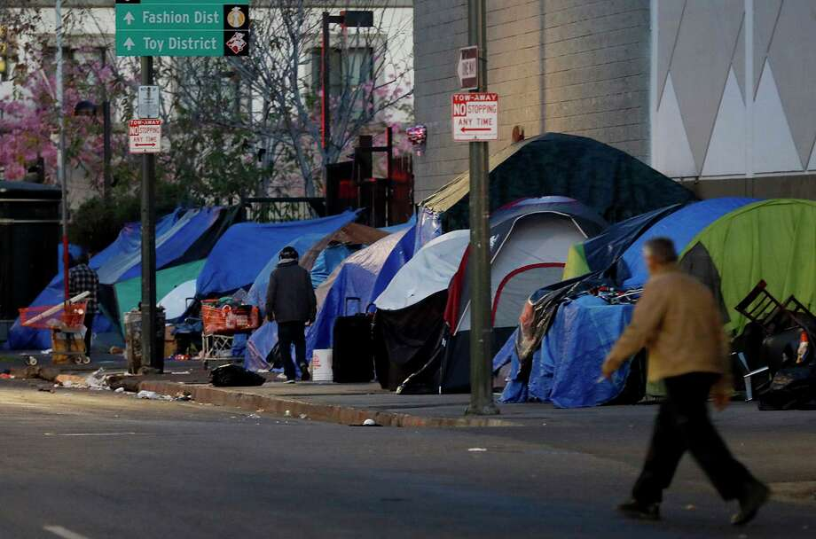 The streets are lines with tents in the skid row area of Los Angeles on Feb. 15, 2018. Among many other things, census data helps states steer efforts for homelessness. (Francine Orr/Los Angeles Times/TNS) Photo: Francine Orr / TNS / Los Angeles Times