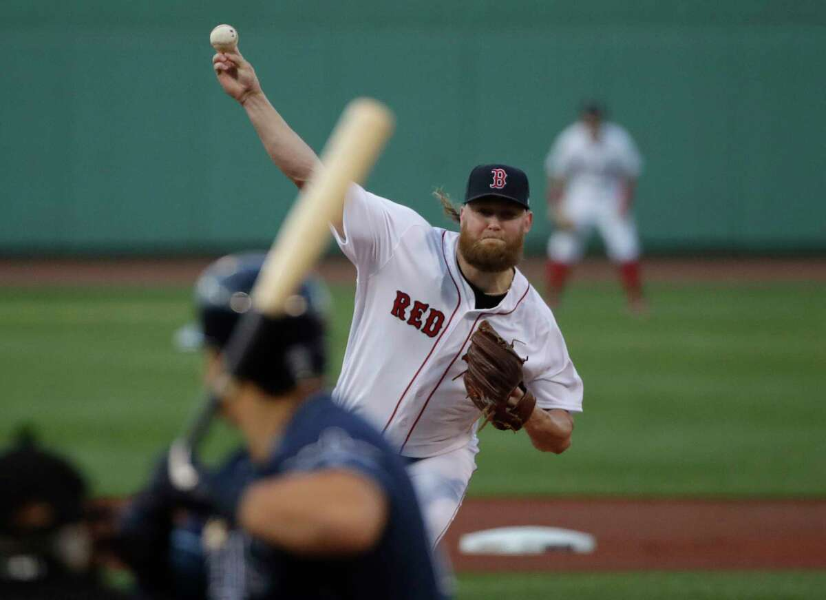 Boston Red Sox starting pitcher Andrew Cashner delivers to Tampa Bay Rays' Austin Meadows during the first inning of a baseball game at Fenway Park, Thursday, Aug. 1, 2019, in Boston. (AP Photo/Elise Amendola)