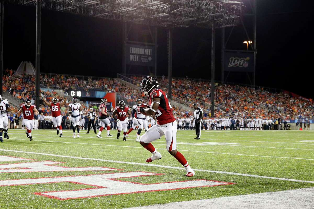 CANTON, OH - AUGUST 01: Brian Hill #23 of the Atlanta Falcons catches a one-yard touchdown pass in the second quarter of a preseason game against the Denver Broncos at Tom Benson Hall Of Fame Stadium on August 1, 2019 in Canton, Ohio. (Photo by Joe Robbins/Getty Images)