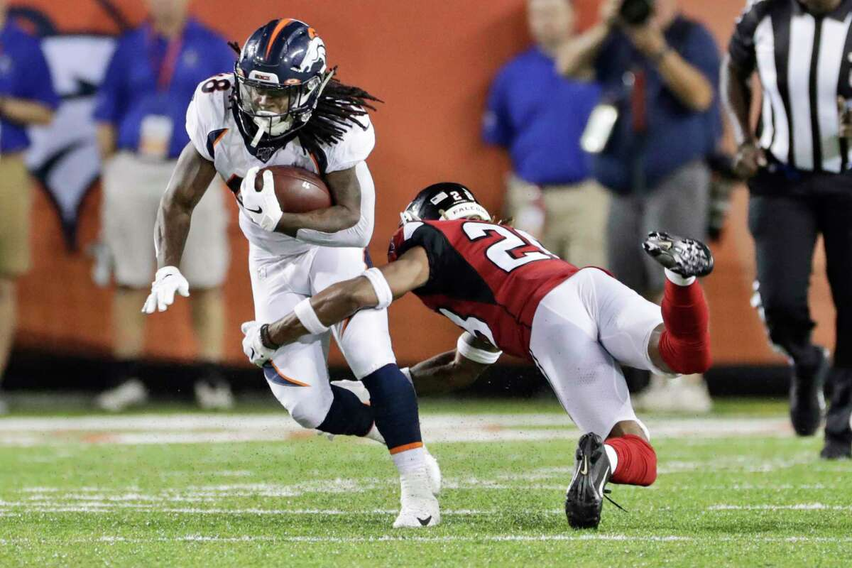 Denver Broncos running back Devontae Jackson (48) breaks a tackle from Atlanta Falcons defensive back Jordan Miller (28) during the second half of the Pro Football Hall of Fame NFL preseason game Thursday, Aug. 1, 2019, in Canton, Ohio. (AP Photo/Ron Schwane)