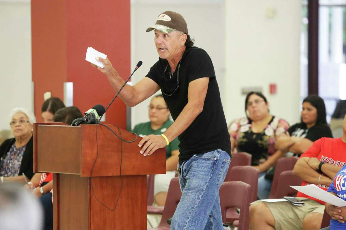 Patricio Esparza demands that board members resign as Harlandale Independent School District trustees hold a town hall meeting at Harlandale High School to hear what residents have to say about the Texas Education Agency's findings of problems in the district and the intent of the state to install a board of managers in place of trustees.