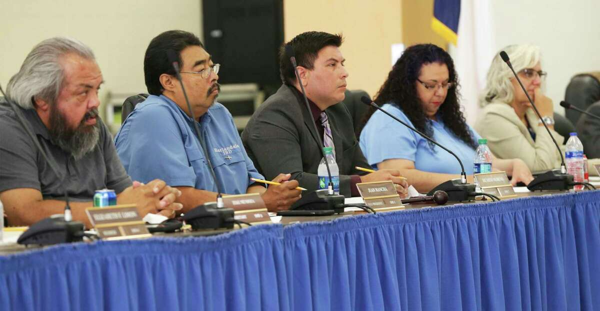 Zeke Mendoza, left, seen in this 2019 file photo, voted against a settlement agreement with Jasmine Engineering at a board meeting Thursday. Veteran trustees Juan Mancha, Ricardo Moreno and Christine Carrillo expressed reluctance to settle with Jasmine Azima, CEO of the engineering firm. The company's decade-long contract, renewed repeatedly by the board without seeking competing offers, was at the center of a long TEA probe of the school district.
