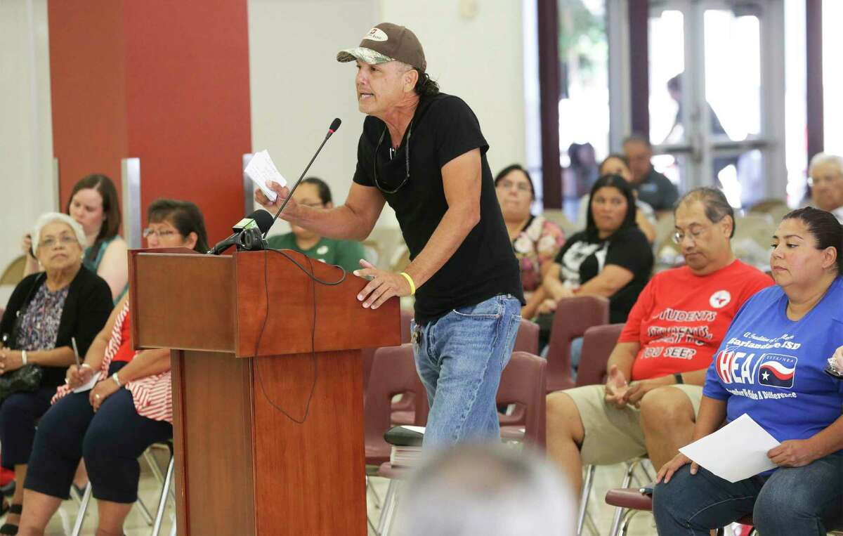 Patricio Esparza demands that members resign as Harlandale trustees offer a town hall meeting on August 1, 2019 at the high school to hear what residents have to say about the Texas Education Agency's findings of problems in the district and the intent of the state to install a board of managers in place of the board of trustees. on August 1, 2019.
