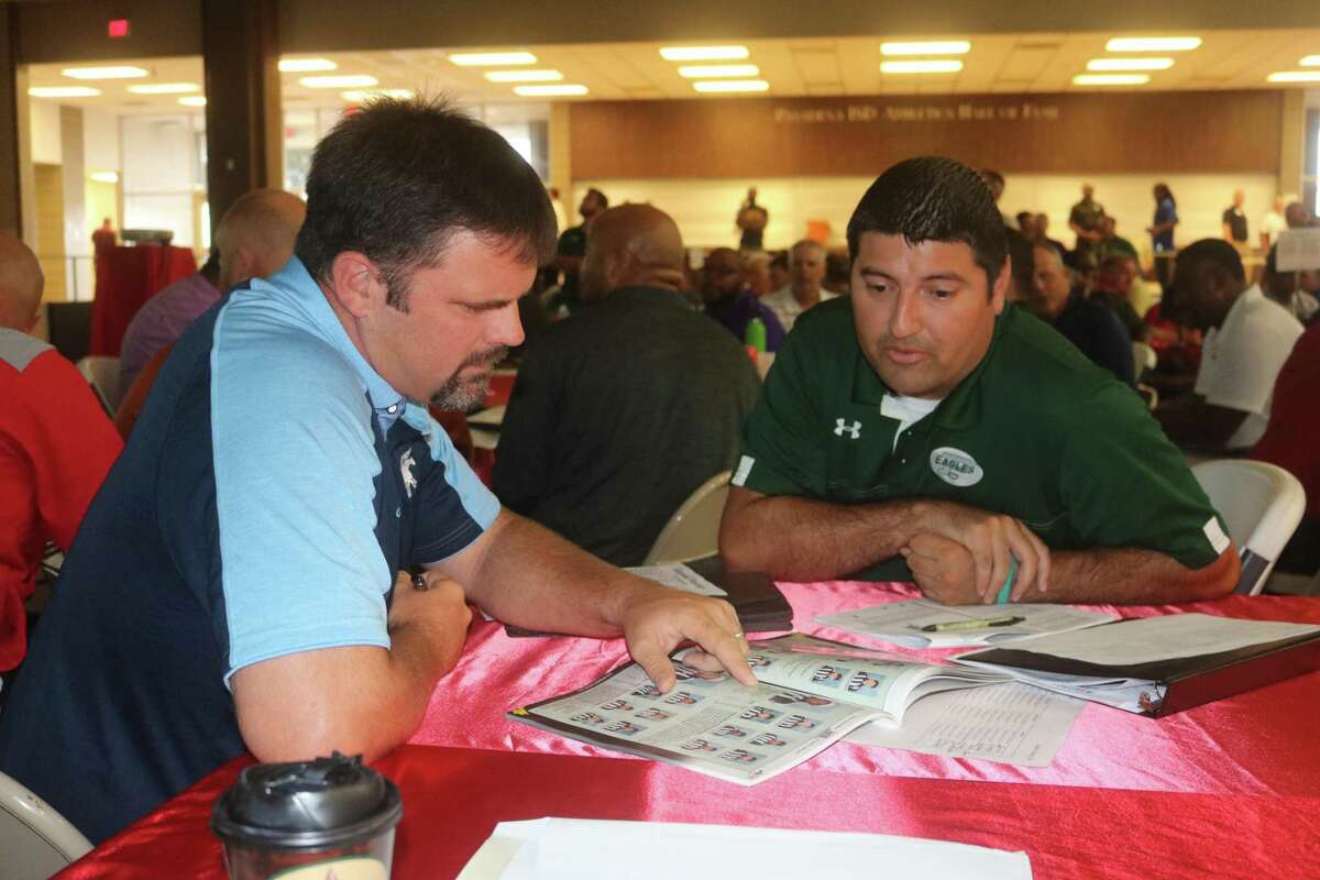 New Pasadena High School head football coach David Zapien confers with a fellow coach at last month's officials selection day. Zapien's Eagles begin practice Monday morning at 8 with two scrimmages on the horizon.