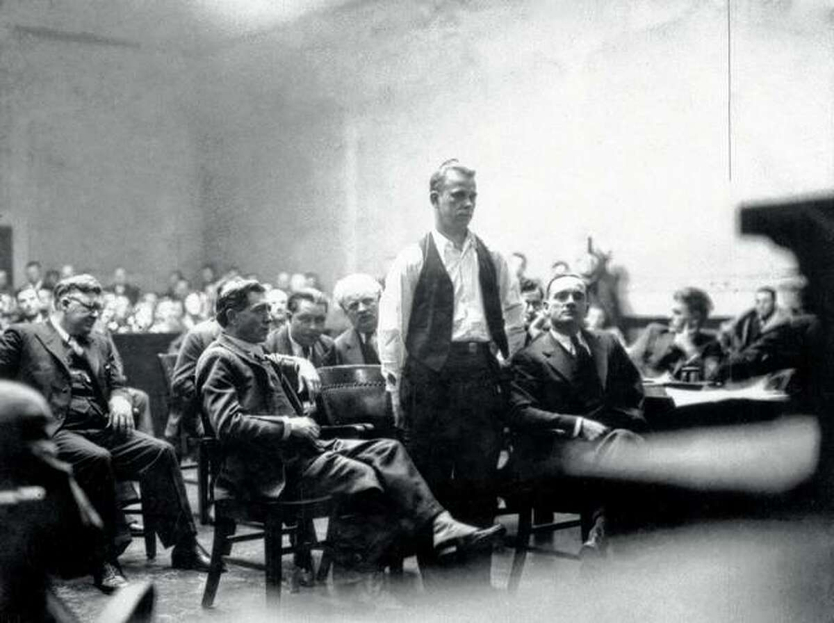 Bank robber John Dillinger stands in court in 1934 in Crown Point, Indiana. Relatives of the gangster are having exhumed a body long believed to be his, saying they have reason to believe it might not be Dillinger's body in the grave.