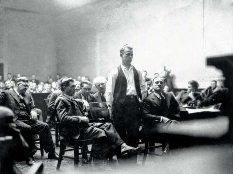 Bank robber John Dillinger stands in court in 1934 in Crown Point, Indiana. Relatives of the gangster are having exhumed a body long believed to be his, saying they have reason to believe it might not be Dillinger's body in the grave. Photo: Chicago History Museum | Getty Images