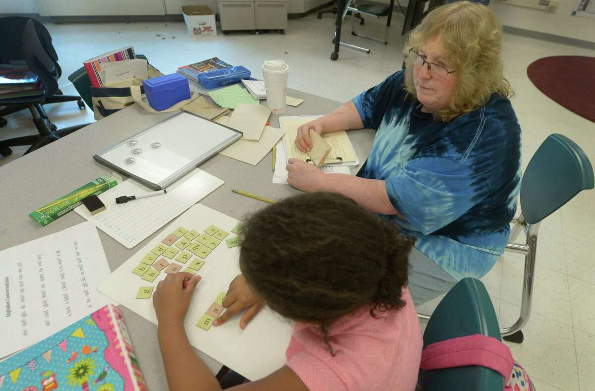 Norwalk Public School teacher Oda Erstling instructs students with dyslexia during a Literacy How program facilitated through the Academy of Orton-Gillingham Practitioners and Educators and sponsored by Fairfield University at Brookside Elementary School Thursday, July 6, 2017, in Norwalk, Conn. Orton-Gillingham is an instructional approach intended primarily for use with persons who have difficulty with reading, spelling, and writing of the sort associated with dyslexia.