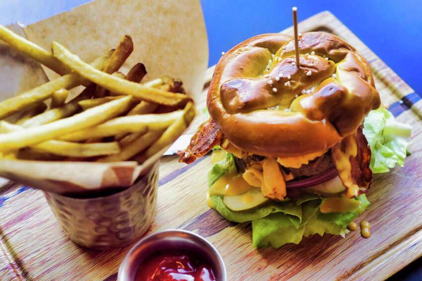 A view of the mac and cheese burger on a pretzel bun at Maggie McFly's inside Crossgates Mall on Monday, July 29, 2019, in Guilderland, N.Y. (Paul Buckowski/Times Union)