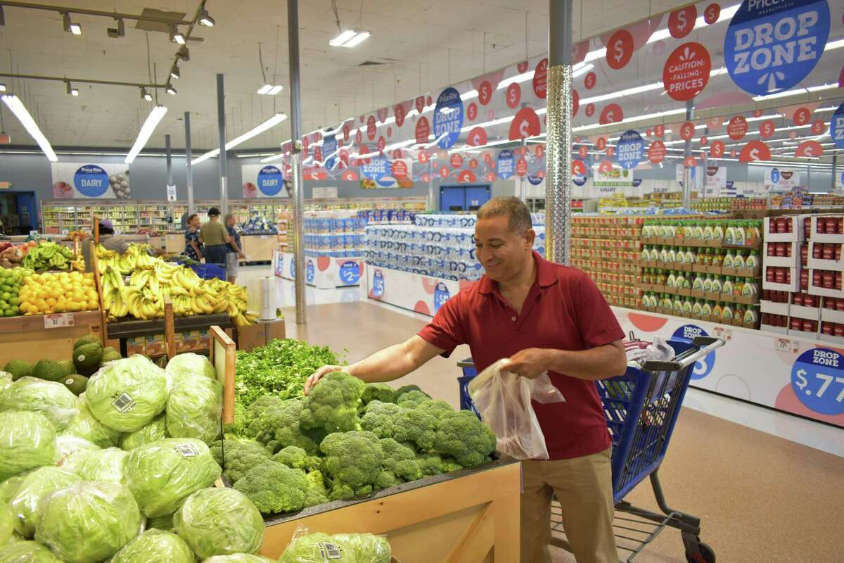 A Price Rite Marketplace shopper picks out broccoli on Friday at the chain's 29 Main St. location in Danbury.