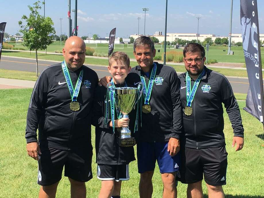 Wilton resident Addison Bergin (with trophy) was part of the AC Connecticut boys 13-under team that won a national championship last week. Photo: Contributed Photo / AC Connecticut Soccer