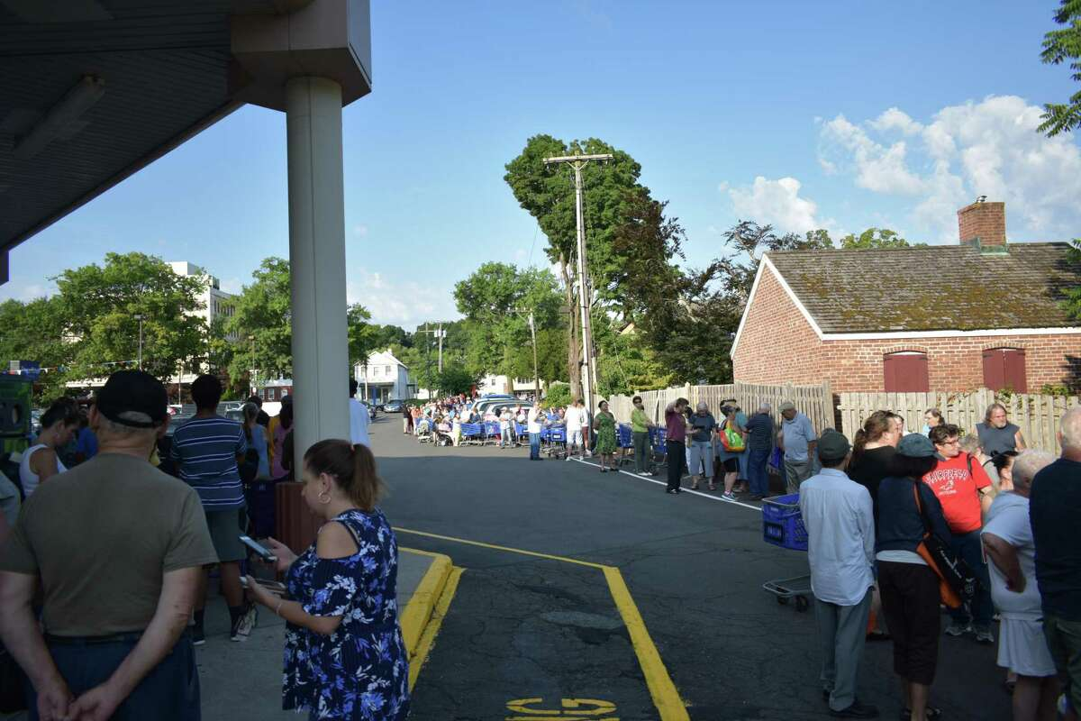 """Shoppers wait on Friday, Aug. 2, 2019, in advance of an 8 a.m. grand """"reopening"""" of Price Rite Marketplace on Main Street in Danbury, Conn."""
