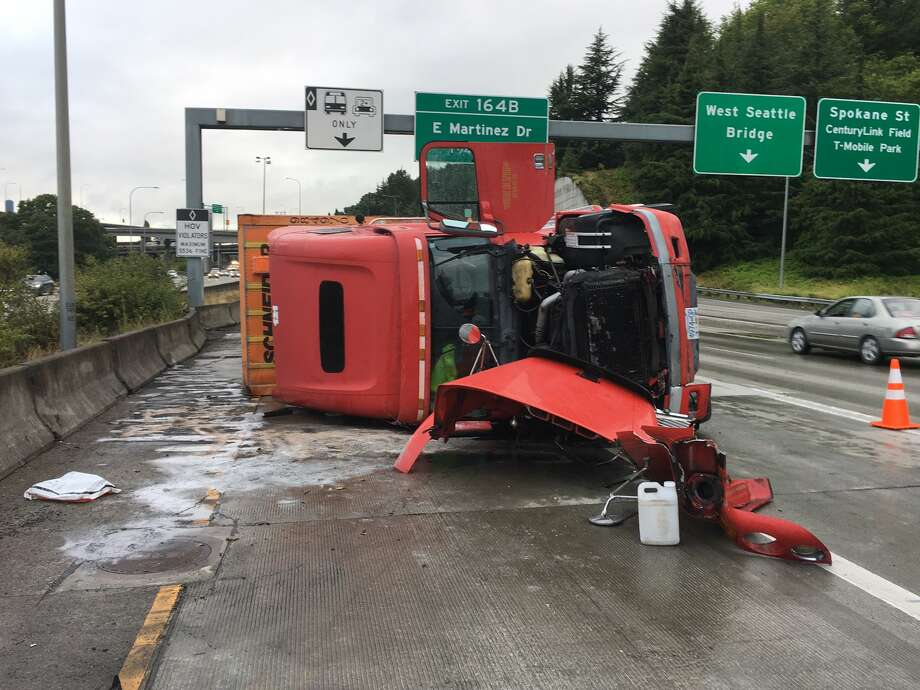 A semi-trailer tractor rolled over on northbound Interstate 5 south of the West Seattle Bridge on Friday morning, blocking lanes and snarling traffic. Photo: Courtesy WSP