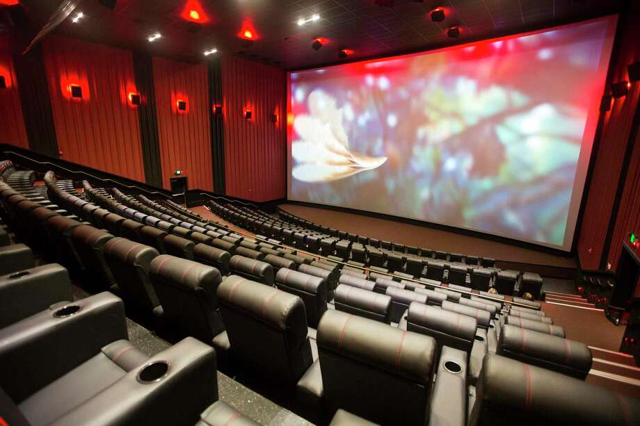 A 70-foot silver screen showcases an all digital projection system and Dolby Atmos surround sound during a media tour of the new ShowBiz Cinemas Kingwood SDX expansion March 18, 2015, in Kingwood. Photo: ANDREW BUCKLEY / Internal