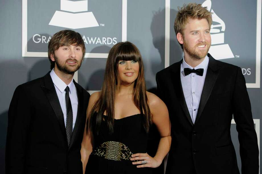 Lady Antebellum, from left, Dave Haywood, Hilary Scott, and Charles Kelley arrive at the 53rd annual Grammy Awards on Sunday, Feb. 13, 2011, in Los Angeles. (AP Photo/Chris Pizzello) Photo: Chris Pizzello / AP / AP