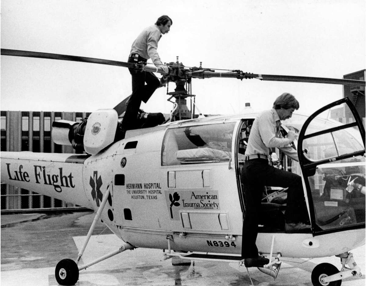 March 1977: Air ambulance pilots Floyd Helm and Tom Locke inspect Hermann Hospital's Life Flight helicopter keeping it ready for flight. They alternate shifts, 48 hours on-duty followed by 49 off. Both are Army-trained pilots who flew in Vietnam.