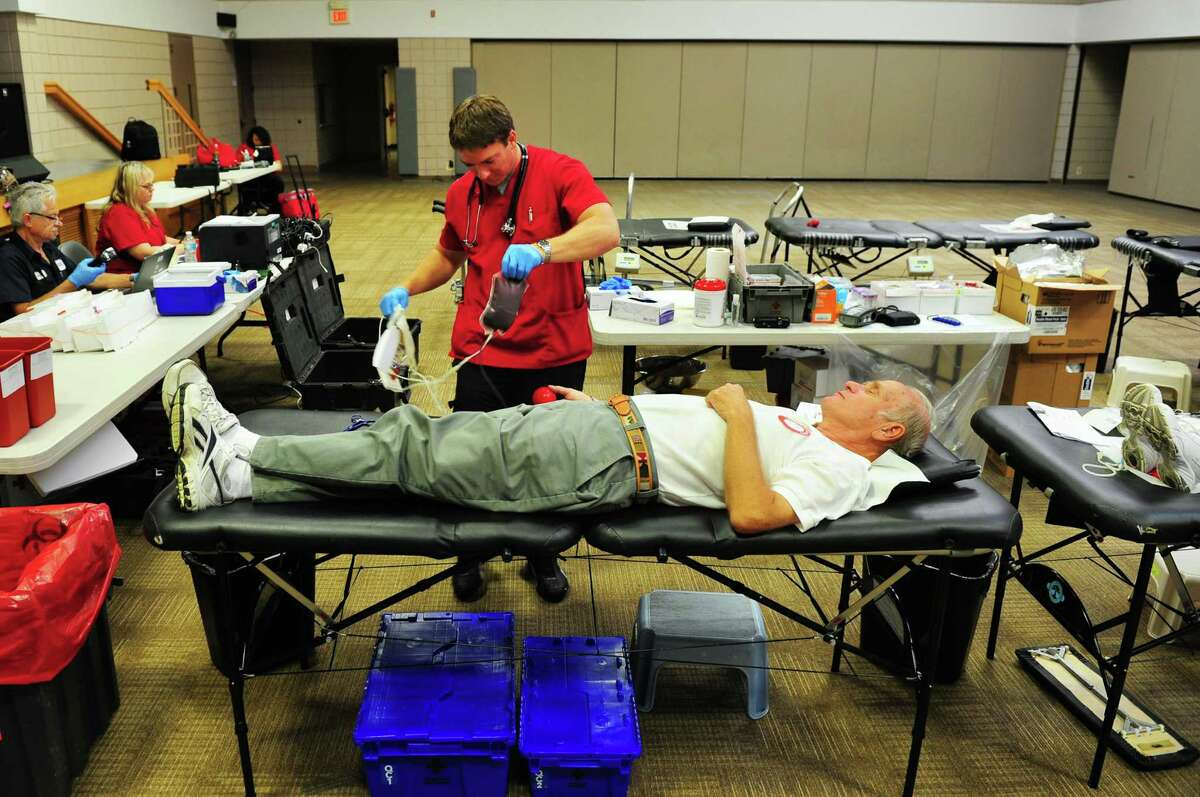 Jerry Anderson donates blood during a Red Cross blood drive held at Calvary Evangelical Free Church in Trumbull, Conn., on Wednesday Aug. 17, 2016. Working with them is phlebotomist Chris Banziruk. The summer months are among the most challenging times of years to collect enough blood and platelet donations to meet patient needs. Many regular donors delay giving while they take vacation and participate in summer activities.
