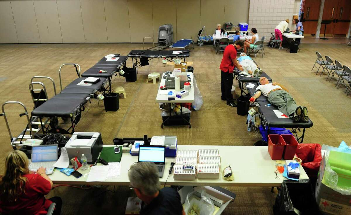 Jerry Anderson and his with Jackie donate blood during a Red Cross blood drive held at Unity Church in Trumbull, Conn., on Wednesday Aug. 17, 2016. Working with them is phlebotomist Chris Banziruk. The summer months are among the most challenging times of years to collect enough blood and platelet donations to meet patient needs. Many regular donors delay giving while they take vacation and participate in summer activities.