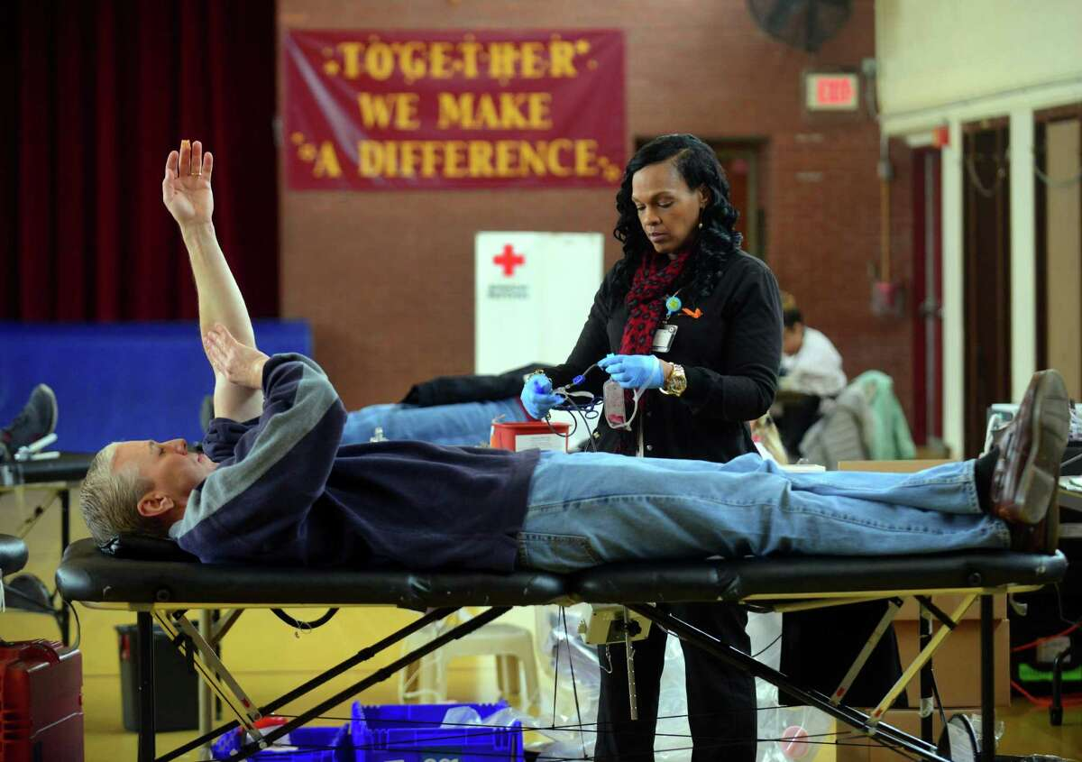 Red Cross Charge Nurse Michelle Lovelace processes blood donated by Ken Janik, of Milford, during a blood drive at St. Teresa School in Trumbull, Conn., on Saturday Apr.1, 2017. Lovelace said that there were 68 appointments slated but they like to hit the goal of 34 people to bring in the needed amount of blood. The blood drive was sponsored by the St. Teresa Knights of Columbus Council 8013.