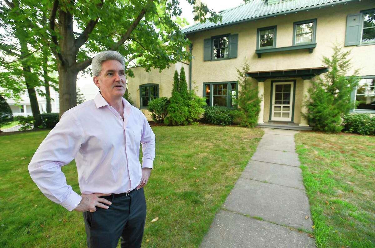 Peter Zeitsch, stands outside his home in the Shippan section of Stamford, Conn., on July 30, 2019. Zeitsch and his family relocated from San Francisco and moved in June to the Italian villa-style house, which stands on Shippan Avenue. The home's sale was brokered by Halstead Real Estate.