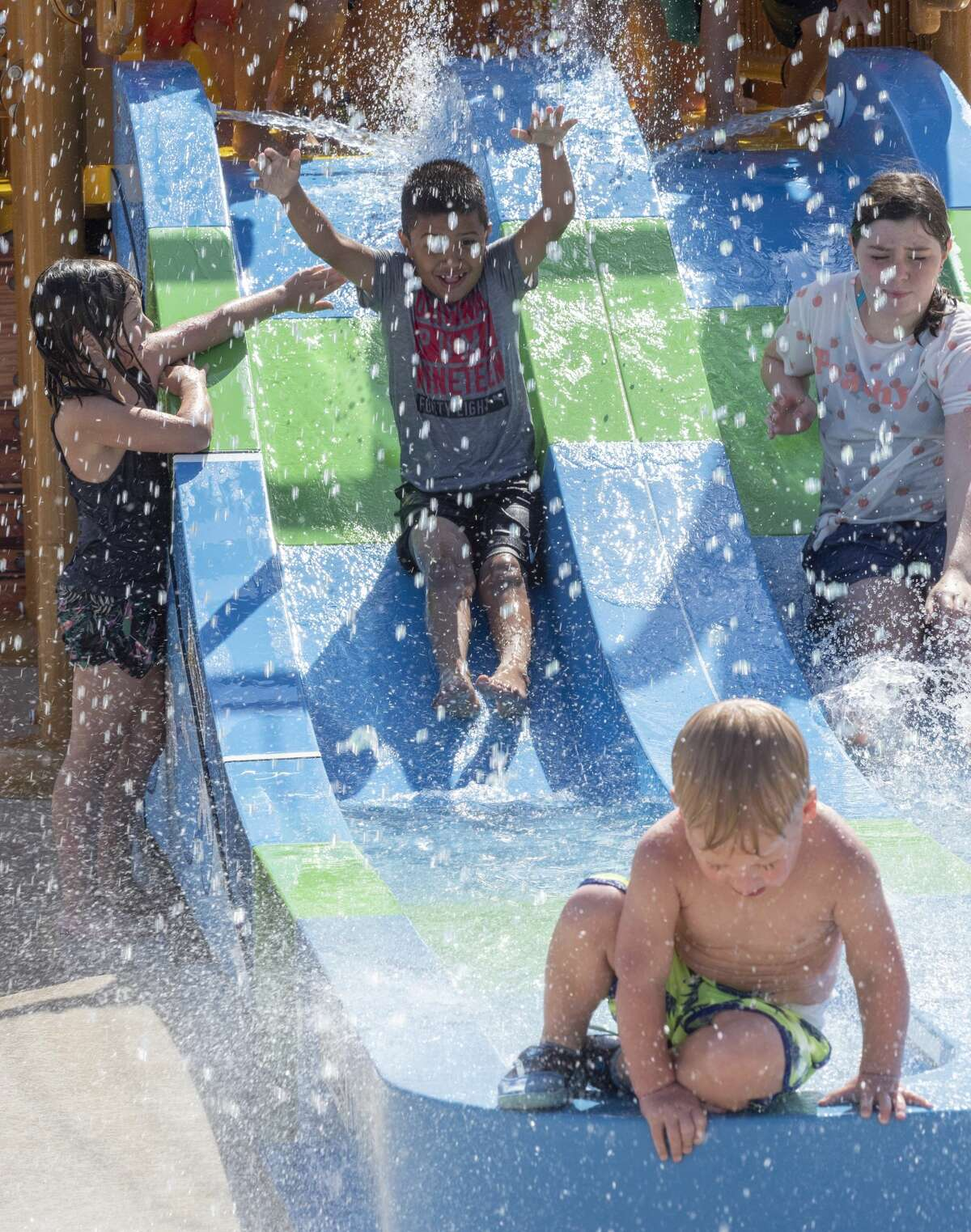Children as well as adults take a break from the heat 08/02/19 as they play in the newly opened Splash Pad at Dennis the Menace Park. Tim Fischer/Reporter-Telegram