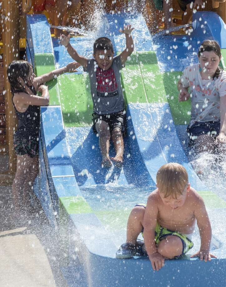 Children as well as adults take a break from the heat 08/02/19 as they play in the newly opened Splash Pad at Dennis the Menace Park. Tim Fischer/Reporter-Telegram Photo: Tim Fischer/Midland Reporter-Telegram