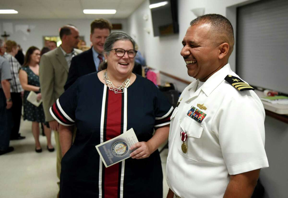 Assemblymember Carrie Woerner takes a moment to speak with Cmdr. Christopher Tejeda, outgoing commander of the Naval Support Activity Saratoga Springs facility, following a change of command ceremony on Friday, Aug. 2, 2019, at the Knights of Columbus Hall in Saratoga Springs, N.Y. (Will Waldron/Times Union)