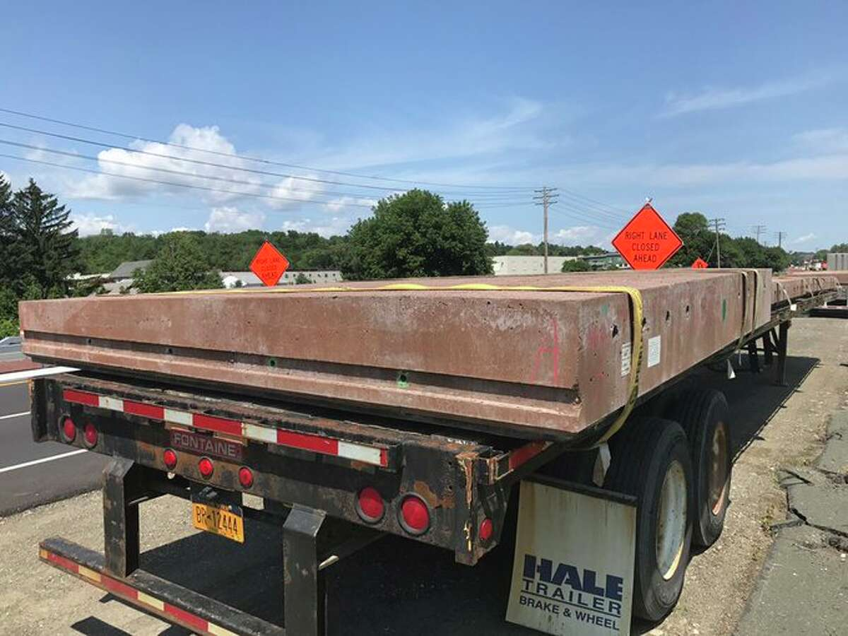 Red, pre-cast panels are being installed this weekend as part of the state Department of Transportation's project to make Cohoes Boulevard safer for pedestrians.