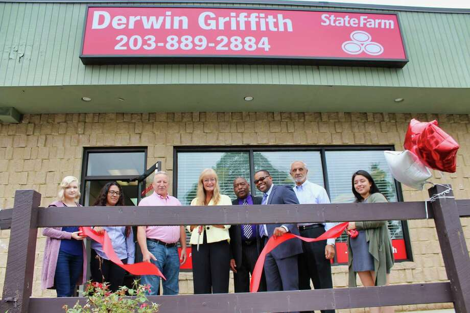 LIKE A GOOD NEIGHBOR: West Haven Mayor Nancy R. Rossi, fourth from left, cuts the ribbon State Farm agent Derwin A. Griffith, third from right, to celebrate the ceremonial opening of the insurance company's new Allingtown office at 444 Forest Road. Also marking the event are, from left, State Farm account managers Cyndal Golbeck and Shakira Rodriguez; City Council Minority Leader Richard DePalma, R-At Large; Griffith's friend and mentor, Leroy Addison; Rossi's executive assistant, Lou Esposito; and State Farm account manager Ashley G. Sanchez. The independently owned office, based in the Oronoque Forest Centre, specializes in a full range of insurance, including policies for auto, home and property, life, health, disability, small business, liability, and identity restoration. It also provides financial services, such as banking and investment options. Photo: Michael P. Walsh - City Photo / Contributed