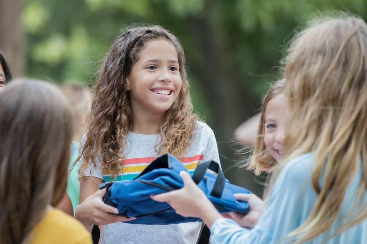 PUT ON COOL ATTIREDress children and infants in loose, lightweight, and light-colored clothing.