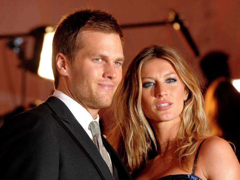 In this May 4, 2009, file photo, New England Patriots quarterback Tom Brady and Gisele Bundchen arrive at the Metropolitan Museum of Art's Costume Institute Gala in New York. The married couple have reportedly looked at homes in Greenwich, Conn. Photo: Peter Kramer / AP / AP2009