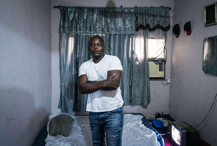 """Definitely there is always conscience,"" said Akinola Bolaji of Lagos, Nigeria, who has conned people online since he was 15. ""But poverty will not make you feel the pain."" Photo: New York Times"