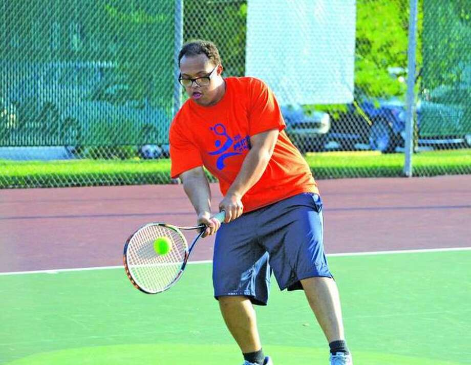 Kamali Mitchell makes a shot during the seventh annual Mitch 'n' Friends night last year at the EHS Tennis Center.