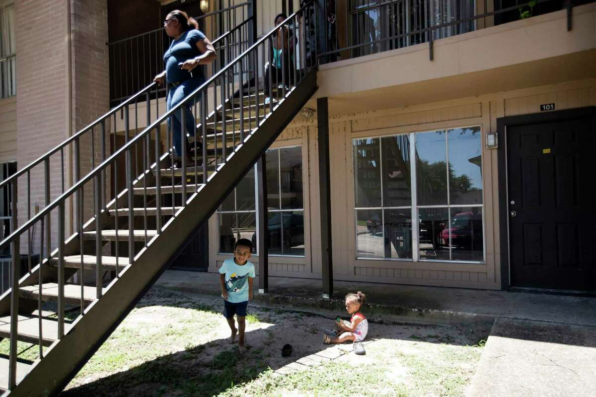 Tomeka Wilson, who lives in flood-damaged Arbor Court apartments in the Greenspoint area, leaves a meeting of residents talking about their struggle to find a new place to live.