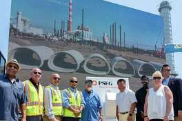 State Sen. Tony Hwang, center right, who represents a portion of Westport, applauded the ceremonial turning-on of a new clean power plant in Bridgeport on July 29. The PSEG Bridgeport Harbor Station 5 came online in June. Its construction is part of an initiative to replace older, coal facilities with newer natural gas ones.