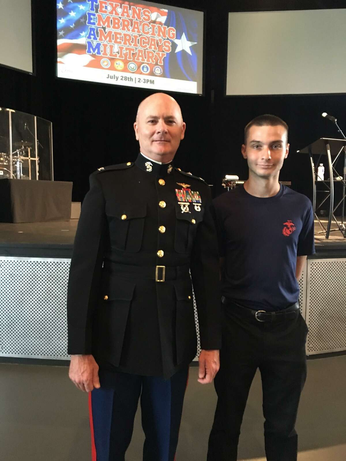 The Texans Embracing America's Military featured retired U.S. Marine Corps Col. James E. Rector of Cypress, left, as the keynote speaker and U.S. Marine recruit Kyle Stevenson.