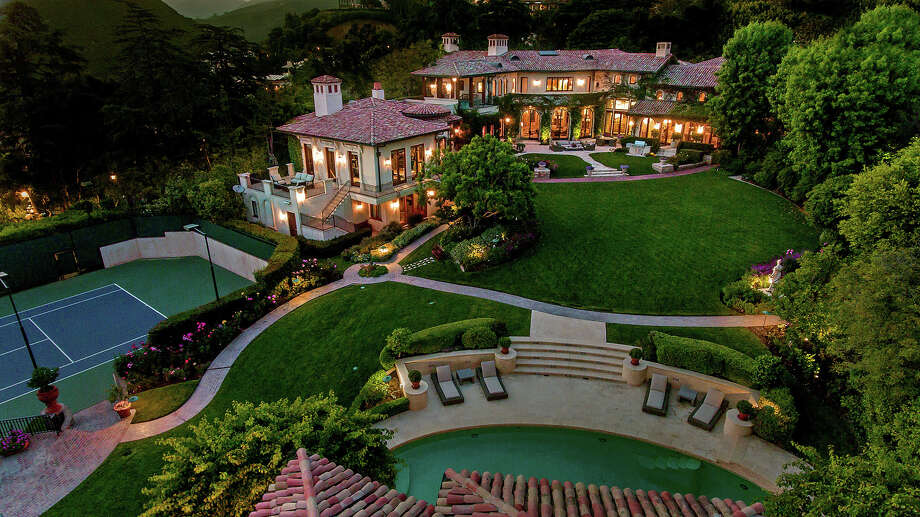Sugar Ray Leonard's home in Los Angeles' Pacific Palisades neighborhood sits on two acres of grounds with a main house and a two-story guesthouse. The two structures are accompanied by a swimming pool, a tennis court and a putting green. (Adam Latham/TNS) Photo: Adam Latham / Los Angeles Times