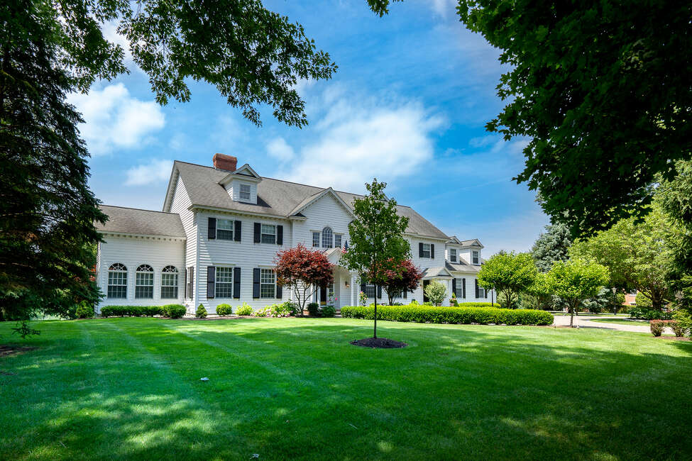 36 E. Ridge Road, Albany: Colonial built in 1997. Views of sunsets and the Schuyler Meadows golf course. Five bedrooms. Highlights are a grand foyer with balcony and sweeping staircase. 5,530 square feet, 1-acre lot. (Photo by Robert Kristel)