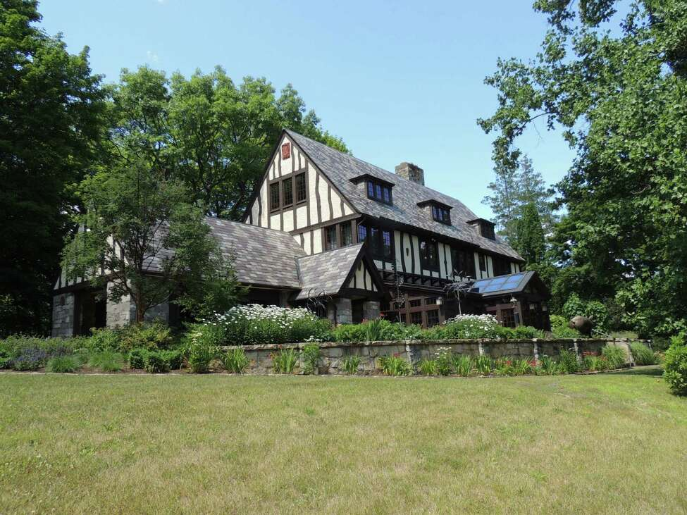 26 Mansion Dr., Copake: Circa 1920 Tudor mansion, 7,178 square feet. Six bedrooms, in-ground gunite pool, clay tennis court and landscaping. 5.2-acre lot. (Photo by Frances Ingraham Heins)