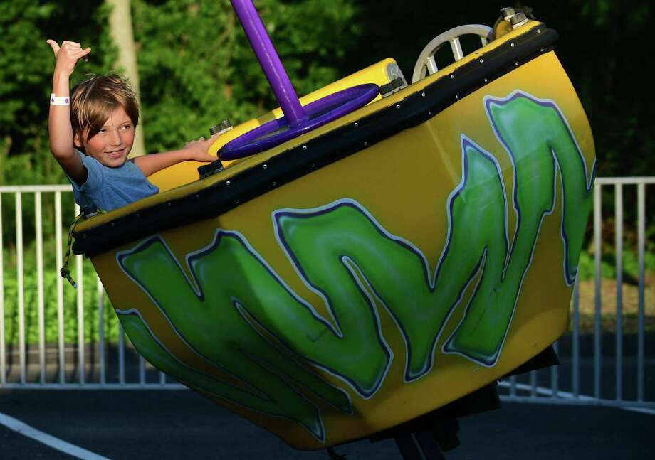Local residents enjoy the St. Matthew Parish annual Summer Carnival of Family Fun Thursday, August 1, 2019, in Norwalk, Conn. In addition to rides, games and food there is a $10,000 CASH 1st-Prize Raffle with the drawing Saturday August 3, at 10pm at the Carnival. Photo: Erik Trautmann / Hearst Connecticut Media / Norwalk Hour