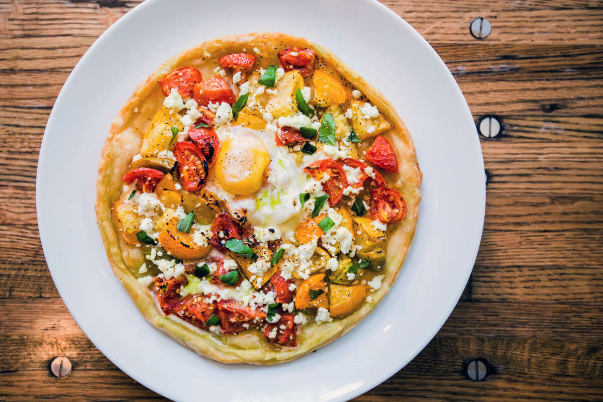 a'Bouzy2300 Westheimer  Brunch: Saturday and Sunday; 10 a.m. to 3 p.m.  Biscuits and gravy, an heirloom tomato galette and egg pizza (pictured), pork hash with braised pork carnitas, jalapeno, cilantro, onions, peppers and eggs and the likes can be yours at River Oaks restaurant, a'Bouzy.