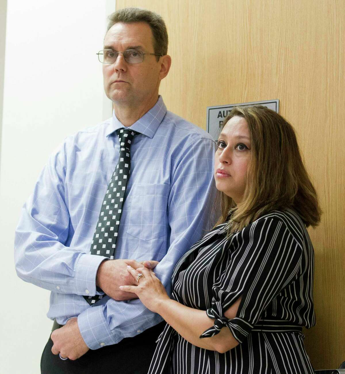 Teresa Gallant, daughter of Teresa Brignoni, holds hands with her husband, Richard, before a hearing for Noel King, Jr. in the courtroom of 359th state District Judge Kathleen Hamilton, Tuesday, July 30, 2019, in Conroe. The case was reopened in April 2017 after the La Porte resident was arrested for the 1983 murder of his fiancée, Teresa Brignoni. King was released from the Montgomery County Jail on a $300,000 bond, but later died.