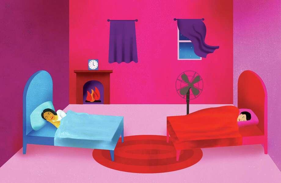 Couples who sleep in the same bedroom are more likely to experience nocturnal disturbances from their partner, potentially leading to health problems, sexual dysfunction and marital spats. Photo: ELLEN WEINSTEIN, STR / NYT / NYTNS