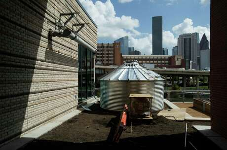 A cistern to collect rain water for seven garden beds are installed outside the University of Houston-Downtown's new College of Sciences & Technology Building on Wednesday, July 17, 2019, in Houston. The building, which mainly hosts biology and chemistry classes and labs, will begin having classes this fall. The garden beds will grow native plants and vegetables.