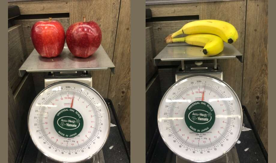 The price of apples and bananas at Safeway versus Trader Joe's varies, and the two stores sell them in different ways at their chain. Photo: Nikki Tran / SFGATE